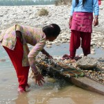Local girls panning for gold, Bardia National Park, Bardia